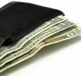 Free Photo - Dollar bills in a black wallet