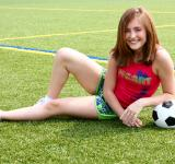 Free Photo - A cute young girl posing with a soccer