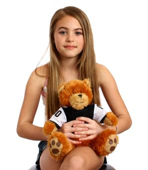 A beautiful girl holding a teddy bear - Free Stock Photo