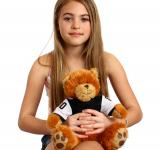 Free Photo - A beautiful girl holding a teddy bear