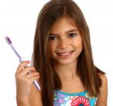 Free Photo - A pretty young girl holding a toothbrush