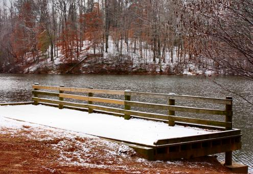 A snow covered dock by a lake - Free Stock Photo