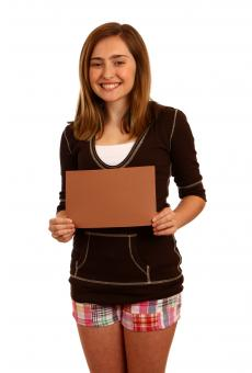 Young girl posing with a blank sign - Free Stock Photo