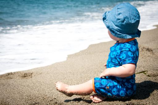 Baby boy on the beach - Free Stock Photo