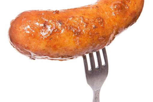 Sausage on fork - Free Stock Photo