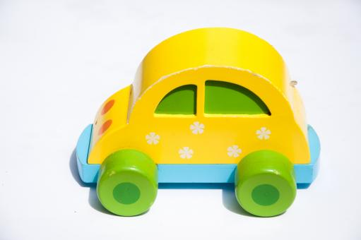 Yellow wooden toy car - Free Stock Photo