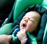 Free Photo - Infant child sitting in car seat