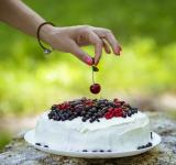 Free Photo - Putting cherry on the fresh berry cake