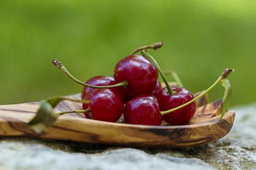 Cherries in wooden spoon - Free Stock Photo