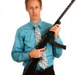 Free Photo - A young businessman holding a rifle