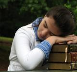 Free Photo - Schoolgirl resting her head on books