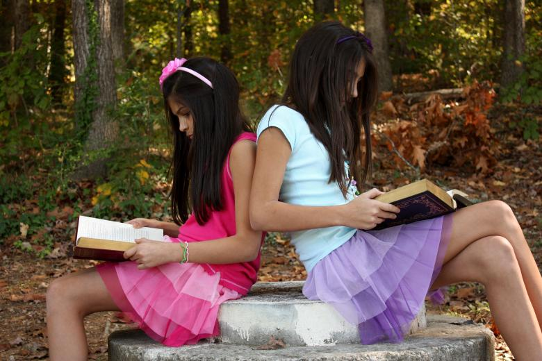 Free Stock Photo of Two cute young girls reading books Created by Benjamin Miller