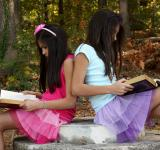 Free Photo - Two cute young girls reading books
