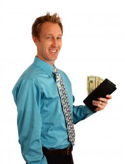 A businessman holding a wallet - Free Stock Photo