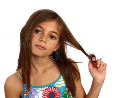 A pretty young girl pulling on her hair - Free Stock Photo