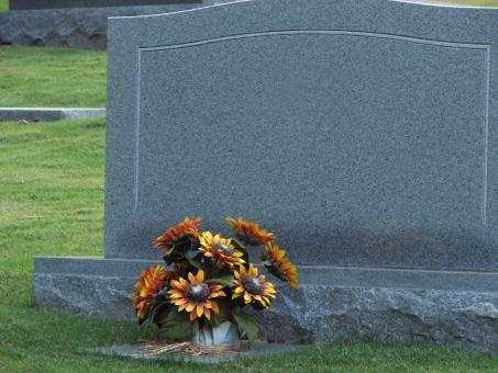 A blank tombstone with flowers - Free Stock Photo