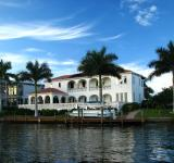Free Photo - A fancy house along the water with palms