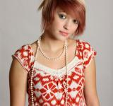 Free Photo - A beautiful young woman wearing pearls