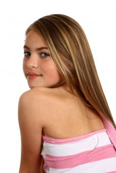 A beautiful young girl posing on white - Free Stock Photo