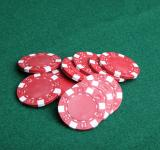 Free Photo - Red poker chips on green felt.