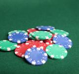 Free Photo - Pile of poker chips on green felt.