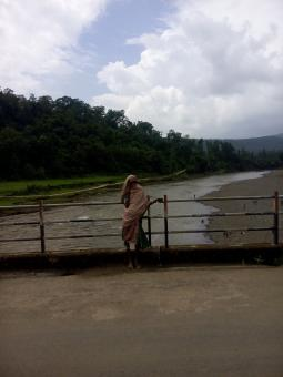 A rural indian women on small bridge  - Free Stock Photo