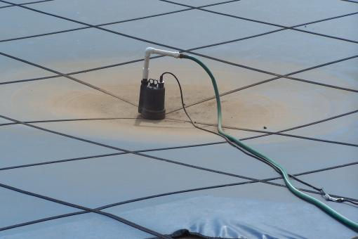 Pump on Pool Cover - Free Stock Photo