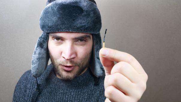 Young man holding a match - Free Stock Photo