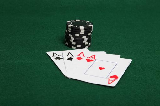 Stack of black poker chips with four ace - Free Stock Photo