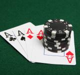 Free Photo - Stack of black poker chips on four aces