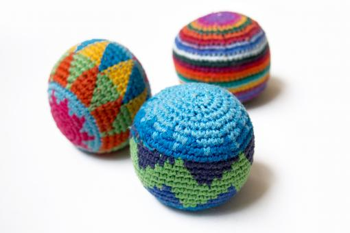 Three multi-colored juggling balls - Free Stock Photo