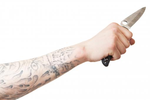 Arm with knife - Free Stock Photo