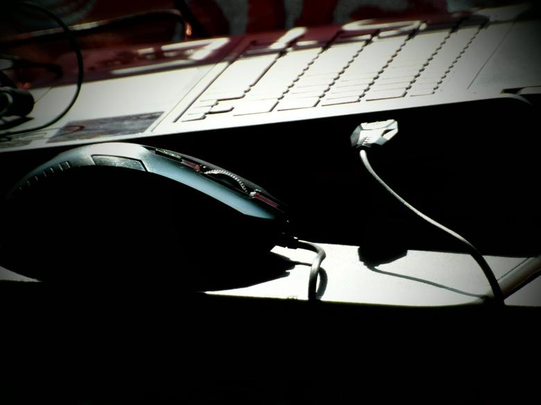 Laptop and Mouse in Shadows Free Photo