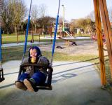 Free Photo - Boy on swing in playground