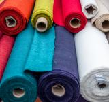 Free Photo - Colorful fabric rolls