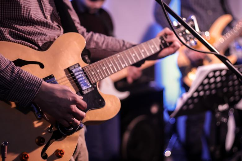 Free Stock Photo of Guitar Player Created by Janis Urtans