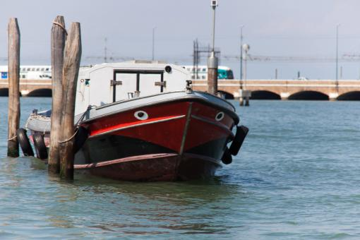 Moored boat with train in background - Free Stock Photo