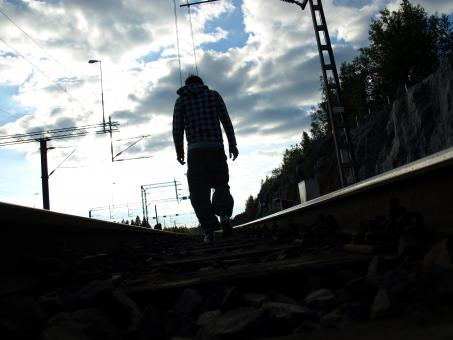 Man walking in railroad - Free Stock Photo