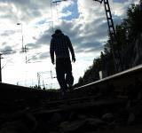 Free Photo - Man walking in railroad
