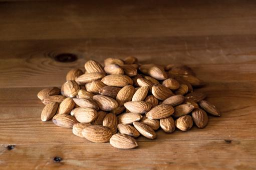 Almonds nuts on rustic wood - Free Stock Photo