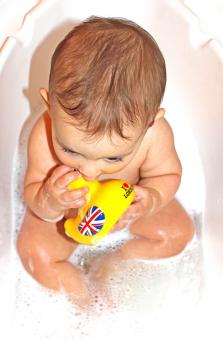 Baby bath with yellow duck toy - Free Stock Photo