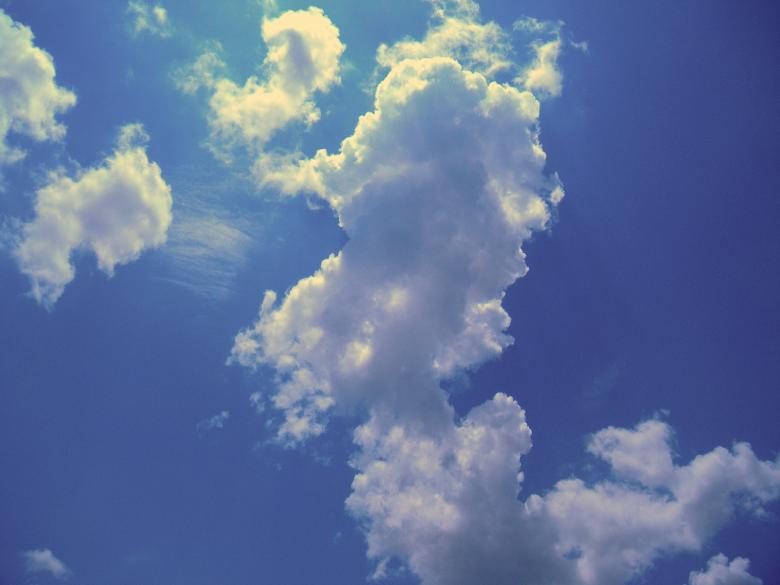 White Clouds In Blue Sky Free Stock Photo