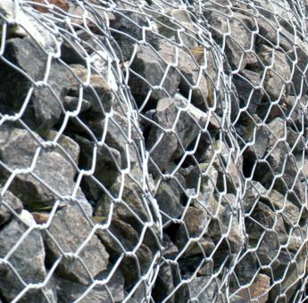 Stone In Chain Link Fence Texture - Free Stock Photo