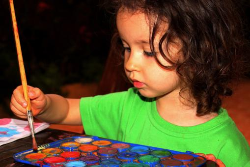 Child painting with aquarel - Free Stock Photo