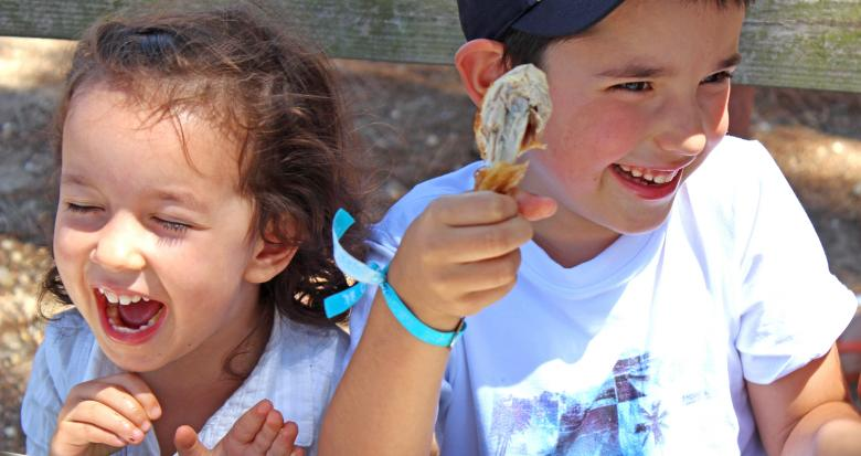 Free Stock Photo of Children eating chicken with their hands Created by Jack Moreh