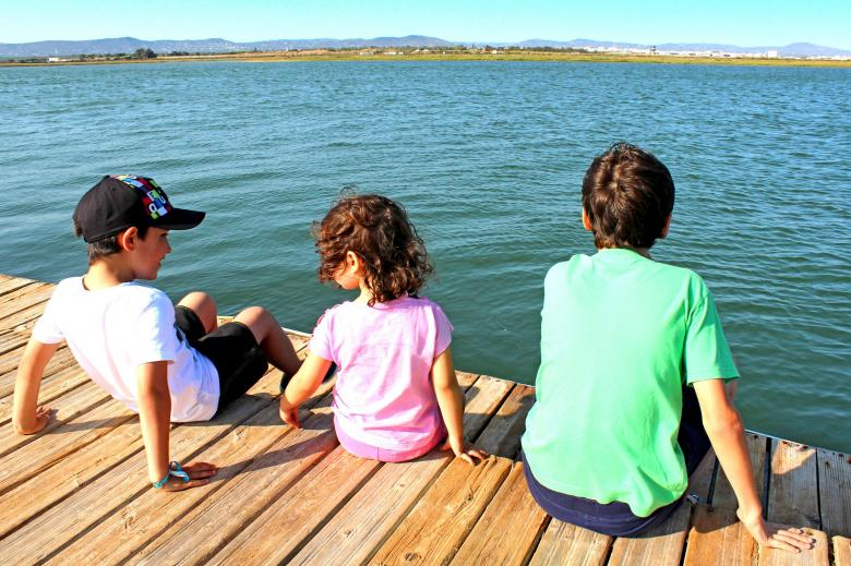 Free Stock Photo of Kids socializing on the pier Created by Jack Moreh