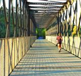 Free Photo - Runner crossing a metal bridge