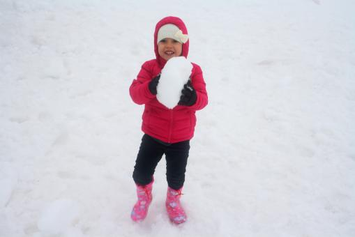 Child playing on the snow - Free Stock Photo