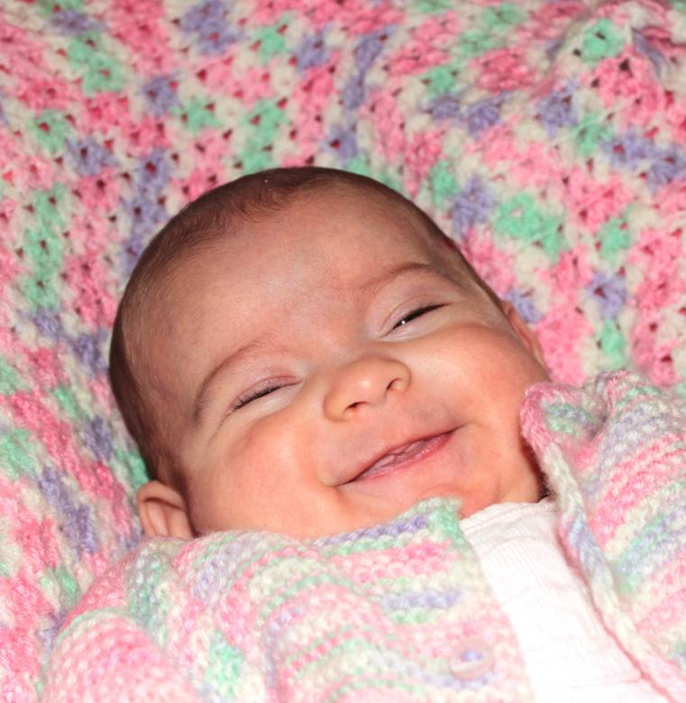 Free Stock Photo of Portrait of a happy baby smiling Created by Jack Moreh