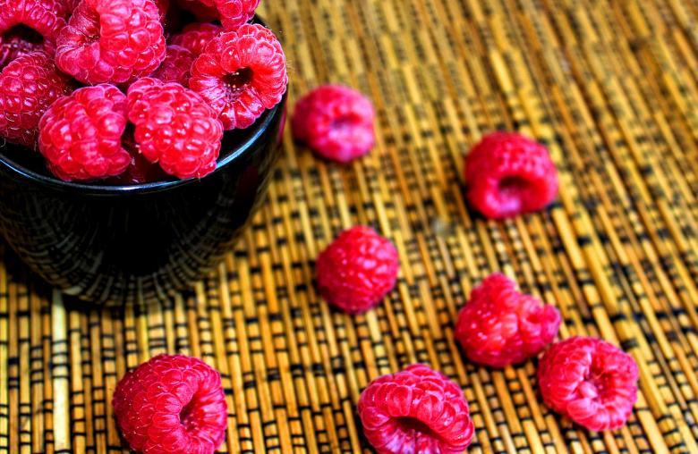 Raspberries on a black cup - Free Summer Stock Photos